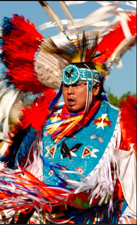 Dancer wears colorful regalia. Crow Fair and Rodeo. Photo: Crow site.