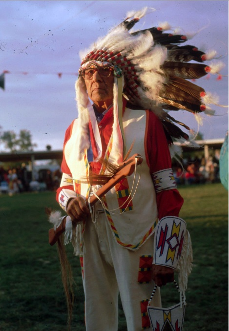 Joseph-Medicine-Crow-about-to-enter-the-dance-arena-at-the-annual-Crow-Fair. Photo-by-Glen-Swanson.