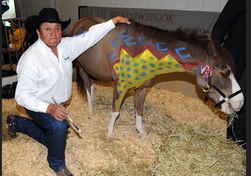 Kennard Real Bird painting a pony as part of the WIHS partnership with Smithsonian's National Museum of the American Indian at WIHS Kids' Day in 2011. (Photo- Lawrence J. Nagy) WIHS.