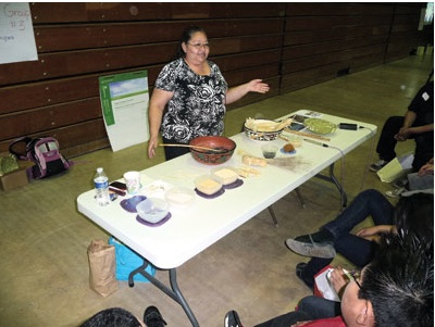 Clara Dallas speaks Hopi as she teaches the names of Hopi food and ingredients at a recent workshop. Photo:Kristin Harned.