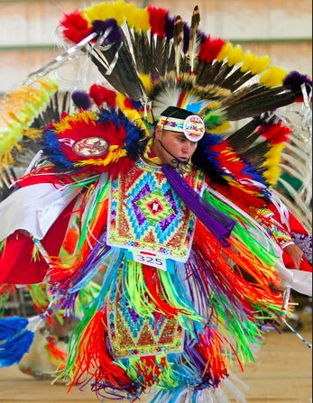 Travis Lovett, of Atlanta, competes in the men's fancy dance during the American Indian Festival Lawrenceville, Ga. Photo- AJC.