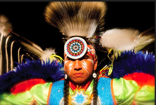Larry Yazzie, dressed in regalia is the arena  director at the University of Iowa  Pow-Wow.ICTNM