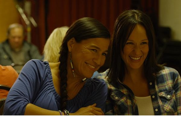 Sisters Janet (Kimberly Guerrero) and Elsie (Stacey Thunder) share a laugh in a scene from The Jingle Dress.