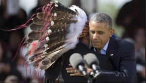 President Barack Obama hugs Standing Rock Sioux Tribal Nation Chairman Dave Archambault II,, in Cannon Ball, N.D., Friday, June 13, 2014, during a Cannon Ball flag day celebration. Credit- Philly News.