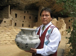 Joshua Madalena with 'Best Of Show' replica pottery of Cliff Palace. Photo taken at Cliff Palace, Mesa Verde, CO. Credit- ICTMN