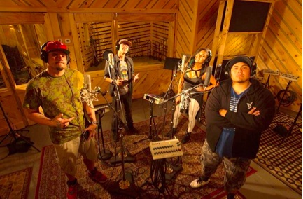 Native American musicians and activists Mike Cliff, left, Frank Waln, Inez Jasper and Nataanii Means record music during MTV World's documentary series Rebel Music- Native America.