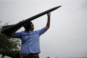Christian Cultee, a student at the Northwest Indian College, with a rocket that broke the sound barrier. Photo- Joshua MCNichols.