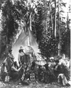 A Native American family gathers around a Christmas tree in Montana, ca. 1900-1920. Library of Congress