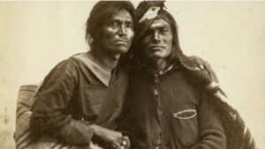 A Navajo two-spirit couple is seen in this historic photo from the collection of the Museum of New Mexico. Photo by Bosque Redondo, 1866.
