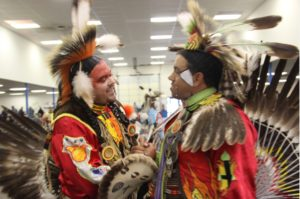 a-handshake-for-brotherhood-after-the-mens-traditional-dance-photo-vincent-schilling